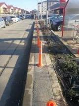 În Popești-Leordeni măsori trotuarul cu rigla, bordura + trotuar = 20 cm