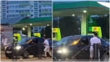 Șoferul de BMW care l-a atacat pe un șofer de Logan a fost reținut, iar partenera sa este căutată